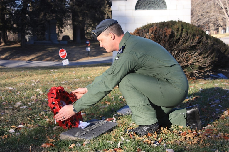 Royal Air Force Master Aircrew Keith Wing, 56 Squadron Rivet Joint specialist, places a wreath at the gravesite of U.S. Army 1st Lt. Jarvis Offutt Dec. 18, 2017, at Forrest Lawn Memorial Park, Nebraska.