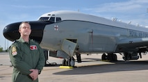 Royal Air Force Master Aircrew Keith Wing, 56 Squadron Rivet Joint specialist, poses in front of a RAF RC-135W Rivet Joint aircraft May 8, 2018, at Offutt Air Force Base, Nebraska.