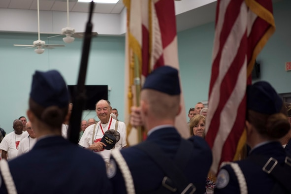 Duke Scales, a volunteer in the Space Coast Honor Flight program, plays morning reveille for all in attendance May 26, 2018 at the Wickham Park Senior Center in Melbourne, Fla. Veterans who served in World War II, the Korean War and the Vietnam War gathered at the senior center to fly to Washington D.C. and visit war memorials dedicated to the sacrifices they made, along with their fellow service members. (U.S. Air Force photo by Airman 1st Class Zoe Thacker)