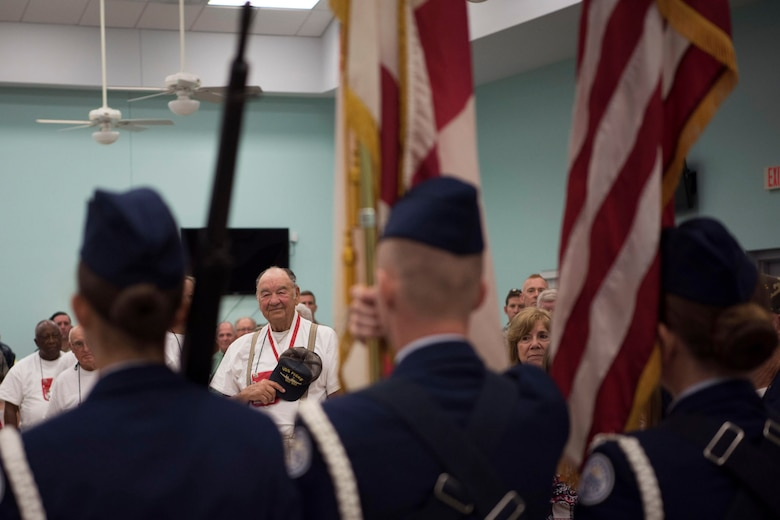 Veterans, current service members, family and friends recite the Pledge of Allegiance as the Colors are presented May 26, 2018 during Honor Flight send off at Wickham Park Senior Center in Melbourne, Fla. 25 veterans, along with their guardians, were able to visit Washington D.C. on this Honor Flight. (U.S. Air Force photo by Airman 1st Class Zoe Thacker)