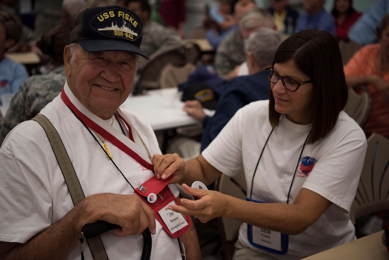 "James ""Jim"" Konopacky, a former U.S. Army National Guardsman and U.S. Navy sailor, has his button pinned on by his guardian Deb Fowler, May 26, 2018 at the Wickham Park Senior Center in Melbourne, Fla. Konopacky served from 1947 until 1955. (U.S. Air Force photo by Airman 1st Class Zoe Thacker)"