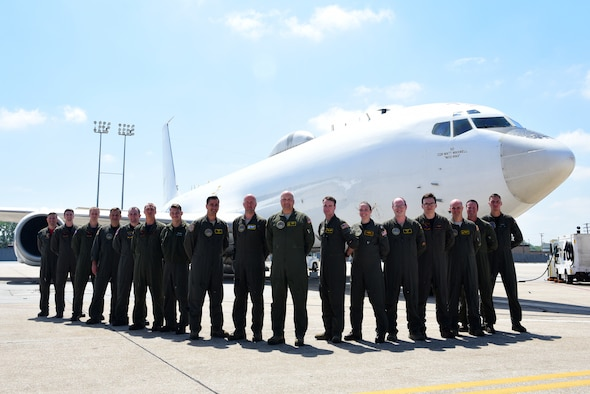 Members of U.S. Strategic Command and the 625th Strategic Operations Squadron stand on the flight line at Offutt Air Force Base, Nebraska, in front of a U.S. Navy E-6B after having pulled a successful alert May 21, 2018. The entire crew worked together to ensure the U.S. was defended in the instance of a strategic attack against the nation. (U.S. Air Force photo by Staff Sgt. Rachel Hammes)