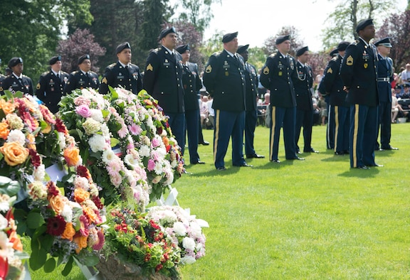 U.S. Soldiers and Airmen stand in honor formation during a Memorial Day ceremony at Flanders Field American Cemetery, Belgium, May 27, 2018. The American Battle Monuments Commission has held Memorial Day ceremonies at Flanders Field since the 1920s, as well as at battle monuments across the world. (U.S. Air Force photo by Senior Airman Elizabeth Baker)