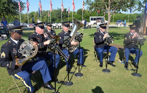 "Members of the 323rd Army Band ""Fort Sam's Own"" play patriotic songs during the Memorial Day ceremony at the Fort Sam Houston National Cemetery May 28."