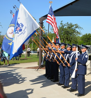 Members of the Southside High Scholl Air Force Junior ROTC present the colors during the Memorial Day ceremony at the Fort Sam Houston National Cemetery May 28.