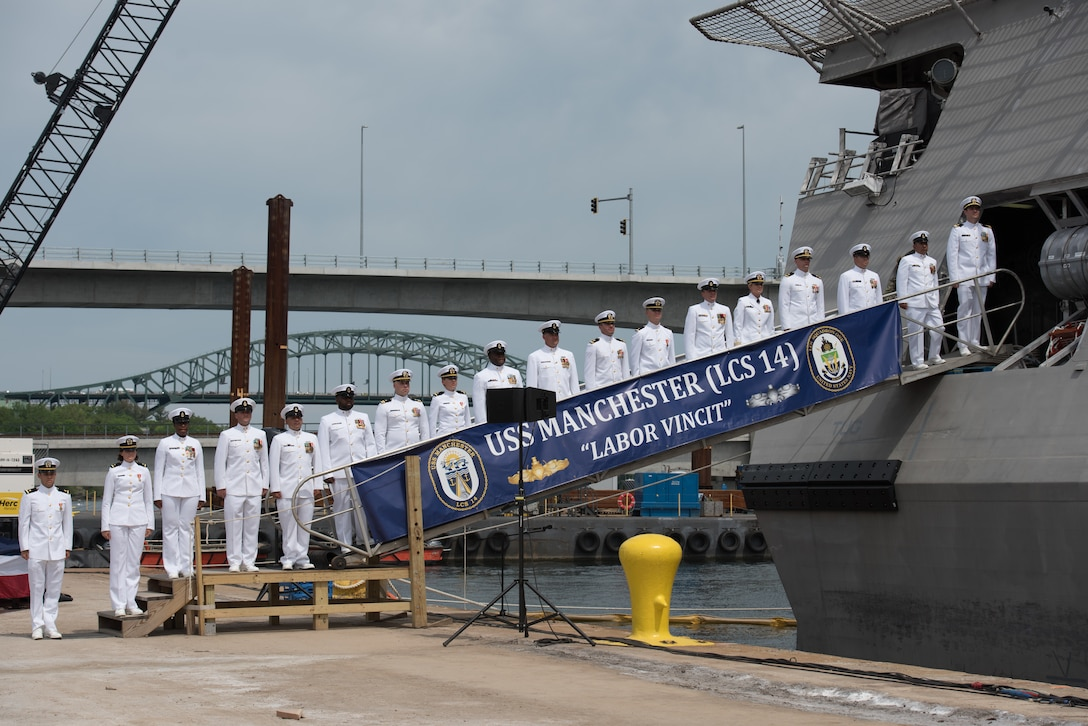 The crew of the littoral combat ship USS Manchester man the rails during the ship's commissioning ceremony in Portsmouth, N.H.