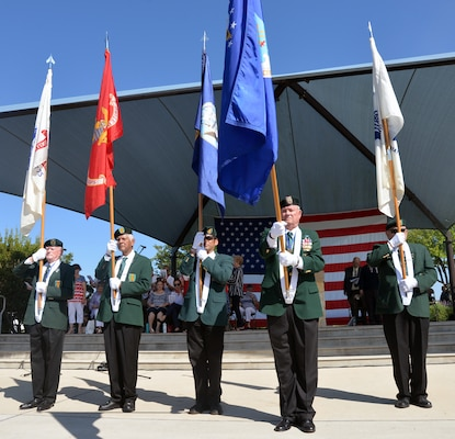 "Members of the Special Forces Association, Chapter XV, present the service flags of each military branch as each service's song is played by the 323rd Army Band ""Fort Sam's Own"" during the Memorial Day ceremony at the Fort Sam Houston National Cemetery amphitheater May 28."
