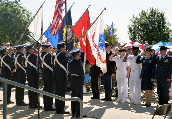 Members of the Southside High School Junior Air Force ROTC Honor Guard present the colors as local military leaders salute during the Memorial Day ceremony at the Fort Sam Houston National Cemetery amphitheater May 28.