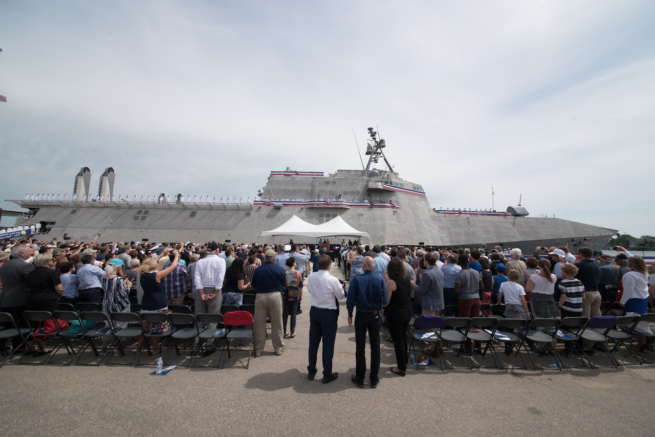 The crew of the littoral combat ship USS Manchester man the rails during the vessel's commissioning ceremony in Manchester, N.H.