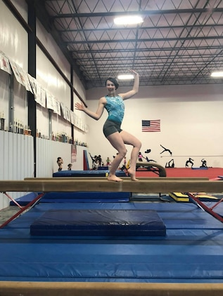 Meghan Fox, a Summer Leadership and Character Development Academy (SLCDA) selectee, poses on a beam in her gymnastics gym, in Hagerstown, Maryland. Meghan is one out of 196 students chosen to attend SLCDA.