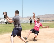 Lance Corporal Tristian Butler, postal clerk, quickly snatches a ball toward third base to beat PFC Collin SanFelice during a softball game held on Sorenson Field aboard Marine Corps Logistics Base Barstow, Calif., May 25. Butler was able to tag SanFelice before he reached the base