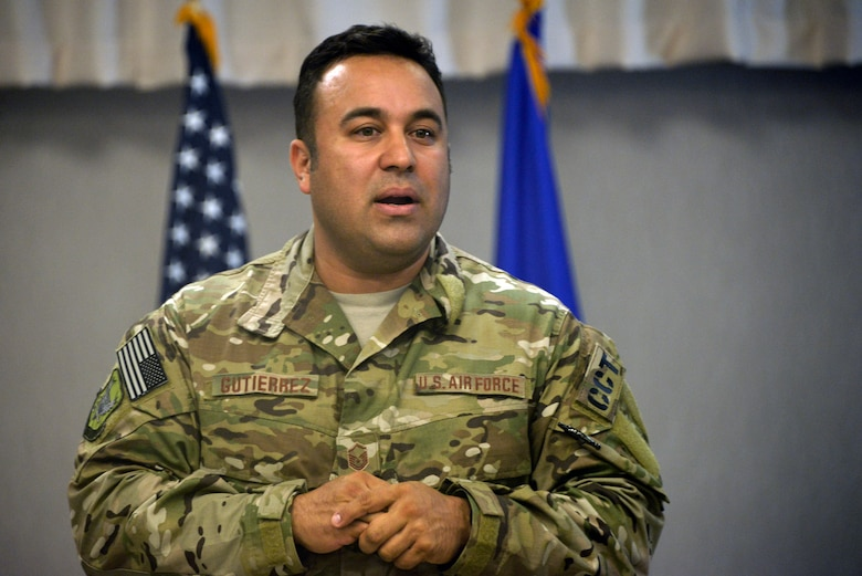 Master Sgt. Robert Gutierrez Jr., Battlefield Airmen Training Group, speaks to Airmen of the 29th Intelligence Squadron, during their Heritage Day ceremony May 18, 2018, in Laurel, Maryland. He explains to Airmen how intelligence saved his life while on the battlefield. (U.S. Air Force photo by Staff Sgt. Alexandre Montes)