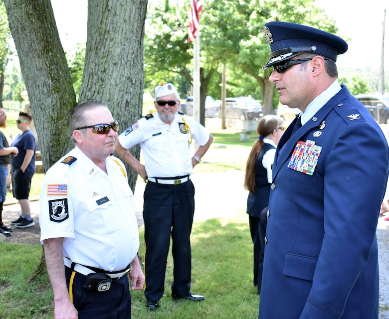 655th Intelligence, Surveillance and Reconnaissance Group Commander John D. McKaye speaks with American Legion Post 598 Honor Guard members before a Memorial Day observance ceremony at Evergreen Cemetery, West Carrollton, Ohio, May 27, 2018
