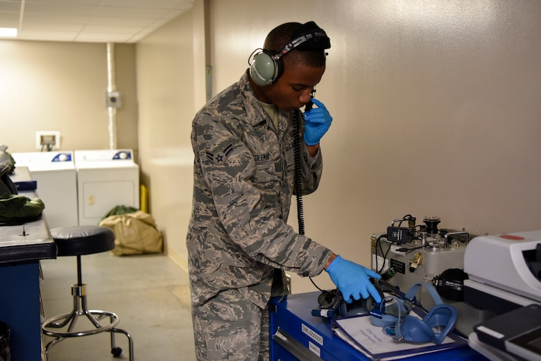 Airman 1st Class David Coleman, 436th Operations Support Squadron aircrew flight equipment apprentice, tests the microphone of a headset May 23, 2018, at Dover Air Force Base, Del. The headsets are used for easy communication between aircrew members during a flight. (U.S Air Force photo by Airman 1st Class Zoe M. Wockenfuss)