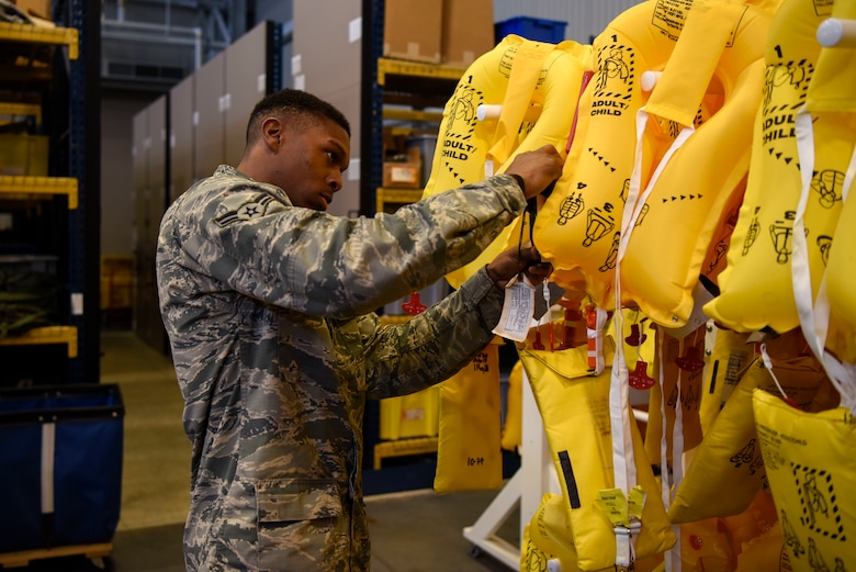 Airman 1st Class Anthony Gray, 436th Operations Support Squadron aircrew flight equipment apprentice, tests inflatable life preservers May 23, 2018, at Dover Air Force Base, Del. The life preservers are provided for the aircrew and any passengers who may be onboard. (U.S Air Force photo by Airman 1st Class Zoe M. Wockenfuss)