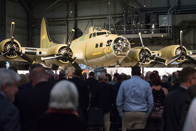 Crowds gather around the B-17F Memphis Belle to get a better look at the conclusion of its unveiling ceremony at the Memphis Belle exhibit inside the National Museum of the U.S. Air Force, Wright-Patterson Air Force Base, May 16. The Memphis Belle is the most famous Flying Fortress, having been the first able to return to the United States following 25 combat missions over occupied Europe during World War II. (U.S. Air Force photo/Wesley Farnsworth)
