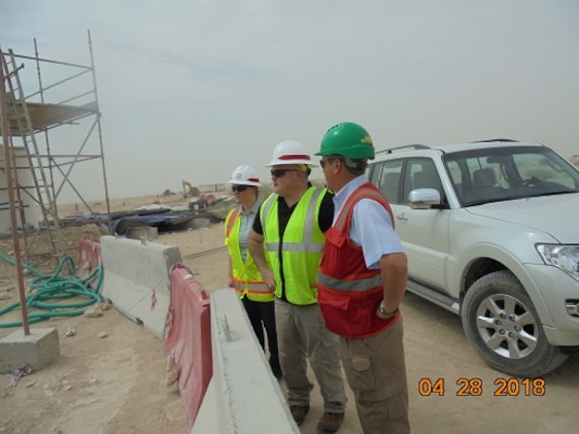 Melanie Barajas, Middle East District's Chief of Safety and Occupational Health, Kevin Raposa, Safety and Occupational Health Specialist TAM Construction Division, and Viv Turner, Site 1 Safety and Security Manager on site in Qatar assessing the construction program and safety program.