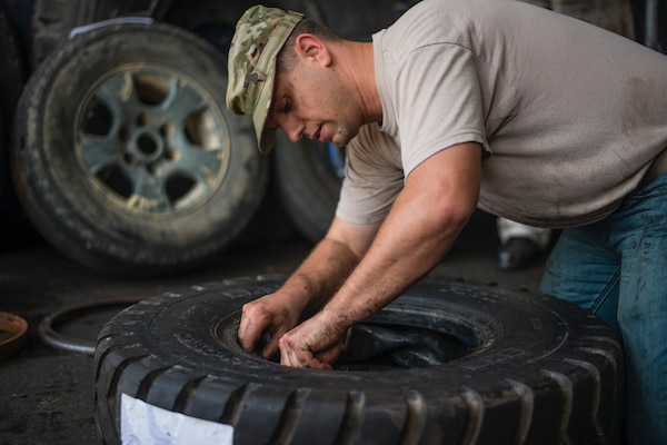 Tech. Sgt. Bryant Friend, 571st Air Mobility Advisory Squadron vehicle maintainer, changes the tires on a forklift while conducting training with the Dominican Republic Air Force in the Dominican Republic, May 3. Friend conducted the first U.S. Air Force assessment of FARD vehicle maintenance operations. He helped them make their sole forklift operational after four months out of service and regain their cargo aircraft loading capability. (U.S. Air Force photo by Staff Sgt. Heather Flitcroft)