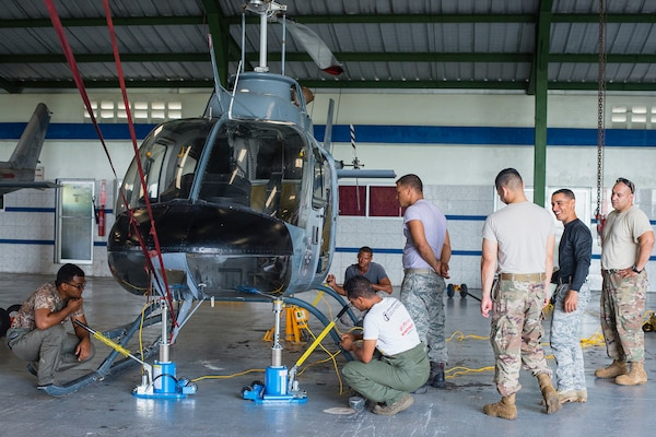 Air advisors from the 571st Air Mobility Advisory Squadron oversee students from the Dominican Republic Air Force as they practice weight and balance positions on a helicopter at the San Isidro Air Base, Dominican Republic, May 3. The MSAS team trained members of the FARD on aircraft weight and balance, corrosion control, hazardous materials management and radio communications.  They also conducted an assessment of vehicle maintenance and operations. (U.S. Air Force photo by Staff Sgt. Heather Flitcroft)