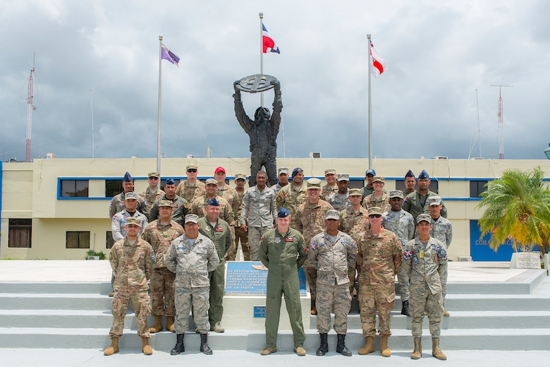Military members from the 571st Air Mobility Advisory Squadron and the Dominican Republic Air Force pose for a photo in front of the headquarters building at the San Isidro Air Base, Dominican Republic, May 4. The MSAS team trained members of the FARD on aircraft weight and balance, corrosion control, hazardous materials management and radio communications.  They also conducted an assessment of vehicle maintenance and operations. (U.S. Air Force photo by Staff Sgt. Heather Flitcroft)