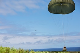 Marines with 3rd Air Delivery Platoon, Landing Support Company, 3rd Transportation Support Battalion, 3rd Marine Logistics Group, conduct a cargo drop from a KC-130 May 22, 2018, on Ie Shima, Okinawa, Japan. The Marines conducted air drop operations dropping a type-five platform, door bundles, free fall and static line jumpers, and the Polaris MRZR4-900 onto the island. 3rd MLG Marines worked alongside Marines with 3rd Reconnaissance Battalion, 3rd Marine Division, during the regularly scheduled training evolution to complete their first successful drop of a Polaris MRZR. (U.S. Marine Corps photo by Pfc. Mark Fike)