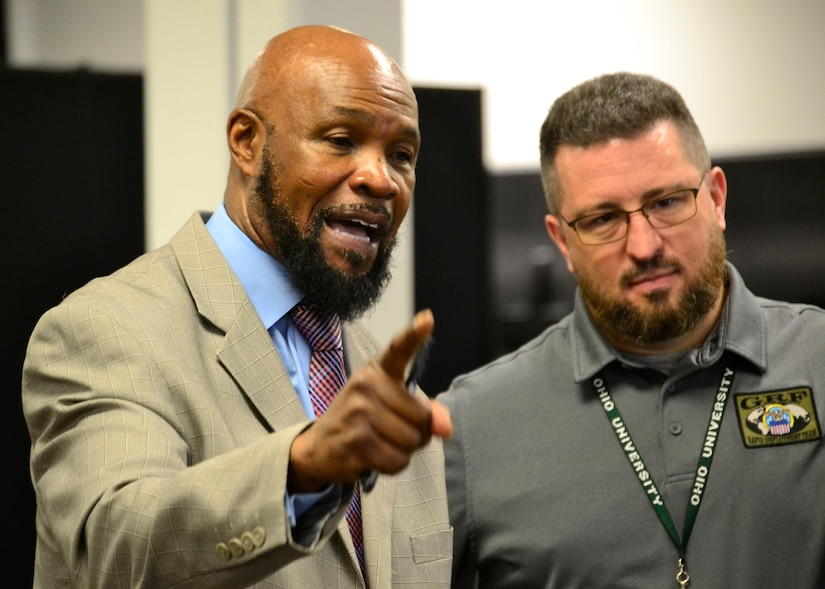 DLA Rapid Deployment Team Red Team deputy commander Archie Turner (left) and RDT Red Team operations officer Taylor Frazier III address DLA Troop Support employees during a humanitarian relief and disaster recovery tabletop exercise May 22 in Philadelphia.