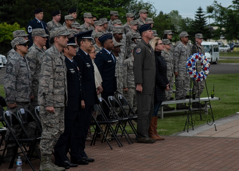 Team Misawa members stand at attention during a Memorial Day ceremony held at Misawa Air Base, Japan, May 25, 2018. Memorial Day is an American holiday, observed on the last Monday of May, honoring the men and women who died while serving in the U.S. military. (U.S. Air Force photo by Airman 1st Class Collette Brooks)