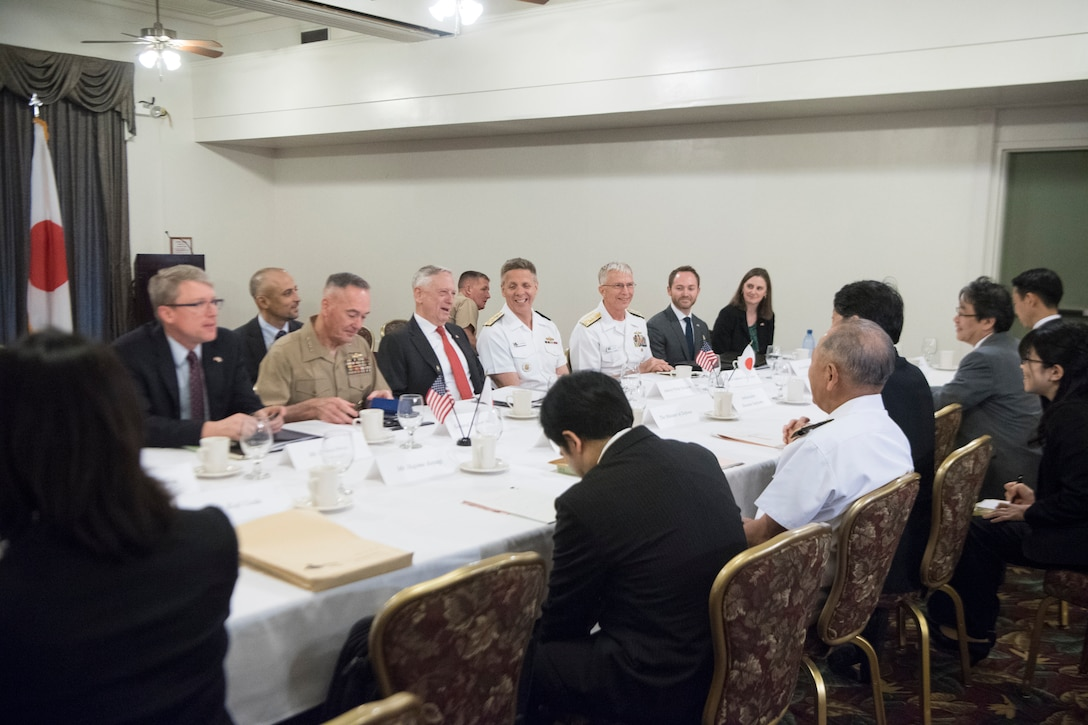 U.S. and Japanese defense leaders meet around a table in Hawaii.