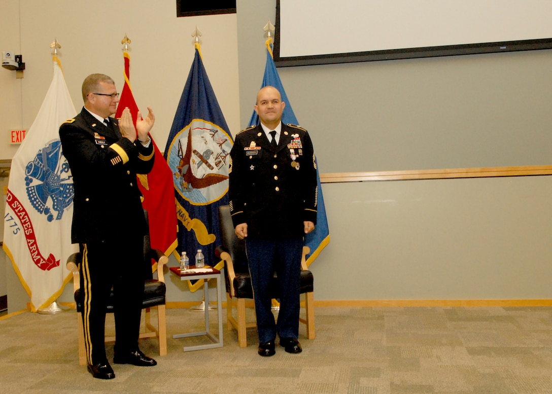 DLA Troop Support Commander Army Brig. Gen. Mark Simerly, left, applauds Senior Enlisted Advisor Army Master Sgt. Jose Moraga during a retirement ceremony in Moraga's honor May 23, 2018 at DLA Troop Support. Moraga thanked his family, friends, and colleagues for their support and sacrifices throughout his military career and beyond.