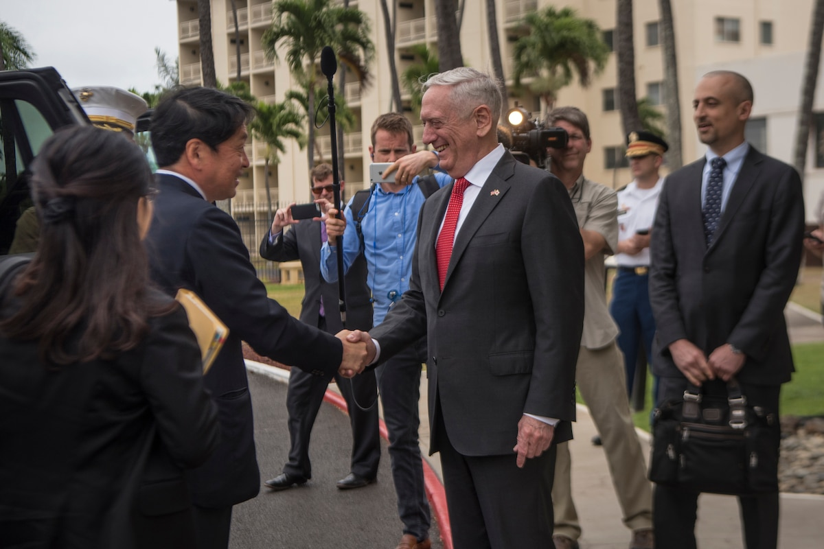 Defense Secretary James N. Mattis shakes hands with the Japanese Defense Minister.
