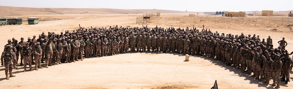 Soldiers with the Jordan Armed Forces and U.S. Army celebrate the graduation of soldiers from the Jordan Operational Engagement Program on April 29, 2018. The nine-week program trained soldiers from the 11th Battalion, Border Guard forces, JAF, on a collection of soldier skills like mortar firing and combat life-saver.
