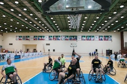 """Soldiers from the 28th Infantry Division, Task Force Spartan, battle to the basket in a wheelchair basketball game at the Kuwait Disabled Sports Club. More than 50 Task Force Spartan Soldiers participated alongside their Kuwaiti neighbors in sporting competitions at the Kuwait Disabled Sports Club, May 9. Continuing the legacy of  """"Every Soldier is an Ambassador,"""" a program to encourage interactions between Americans and Kuwaitis, Soldiers of the 28 ID were among a combined group of more than 100 Kuwait and U.S. Army athletes participating in sporting events held at Kuwait Disabled Sports Club."""