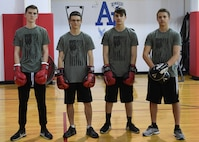 Ethan Conrad, student at Ambridge Area Junior High School in Freedom, Pa, Nathan Erickson, Nick Preza, and Logan Erickson, students at Ambridge Area Senior High School, in Ambridge, PA, pose for a photo at the Fitness Center at Pittsburgh International Airport Air Reserve Station May 5, 2018. These students are all Marine Corps Junior ROTC studnets at Ambrige Area Senior High School and are part of the Warriors' Call Boxing Club in Braeden, PA. (U.S. Air Force Photo by Airman 1st Class Grace Thomson)