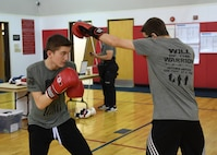 Ethan Conrad, student at the Ambridge Area Junior High School in Freedom, PA, and Nathan Erickson, student at the Ambridge Area Senior High School in Ambridge, PA, practice dodging punches at the Fitness Center at the Pittsburgh International Airport Air Reserve Station May 5, 2018. They also demonstraed basic boxing moves during the practice for onlookers. (U.S. Air Force Photo by Airman 1st Class Grace Thomson)