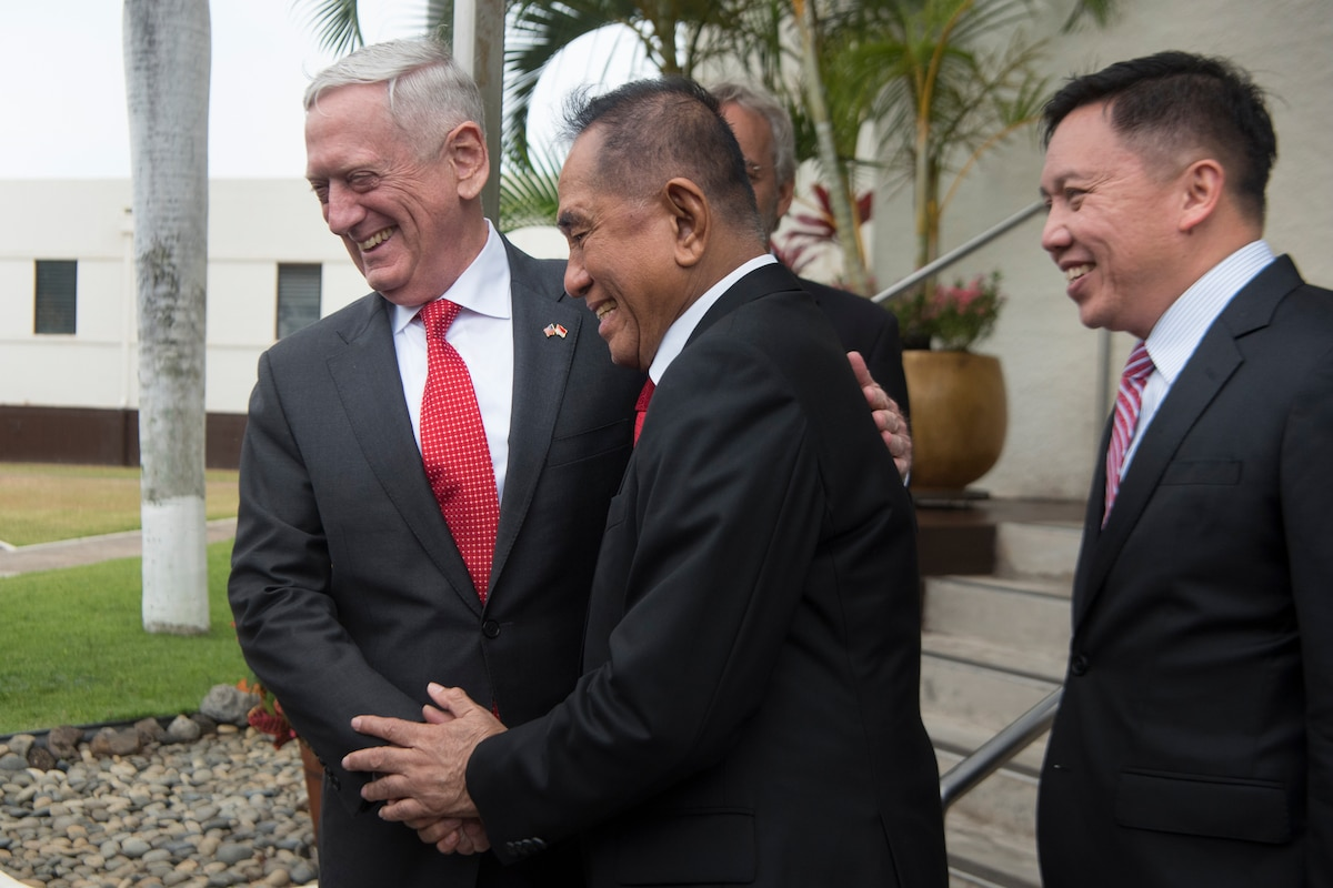 Defense Secretary James N. Mattis greets the Indonesian Minister.