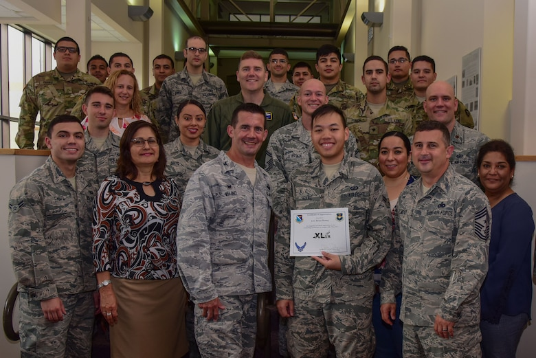"Airman 1st Class Brian Hoang, 47th Comptroller Squadron financial service technician, was chosen by wing leadership to be the ""XLer"" of the week, for the week of May 21, 2018, at Laughlin Air Force Base, Texas. The ""XLer"" award, presented by Col. Charlie Velino, 47th Flying Training Wing commander, is given to those who consistently make outstanding contributions to their unit and the Laughlin mission. (U.S. Air Force photo by Airman 1st Class Marco A. Gomez)"
