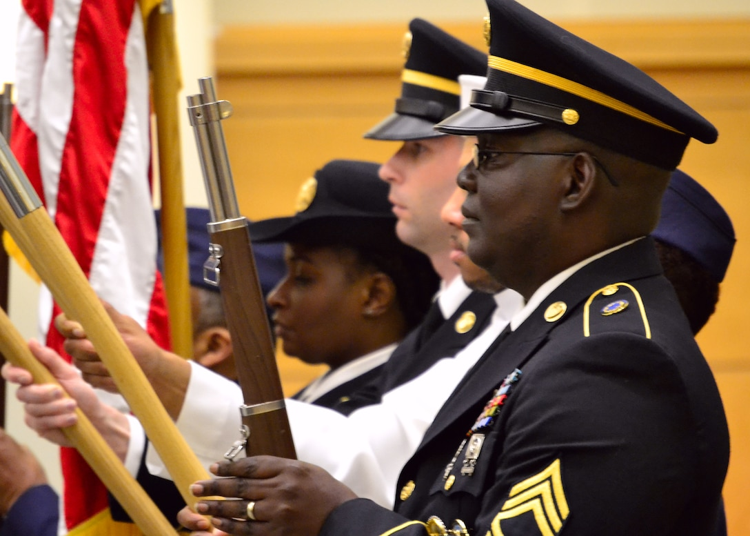 """The Compound All Service Color Guard presents the colors during the Philadelphia Compound Veterans Committee Memorial Day observance May 24. The observance featured keynote speaker Randall """"Adam"""" Bethke, a retired Army chief warrant officer, who spoke about the deep connection with memorial Day he learned from his father."""