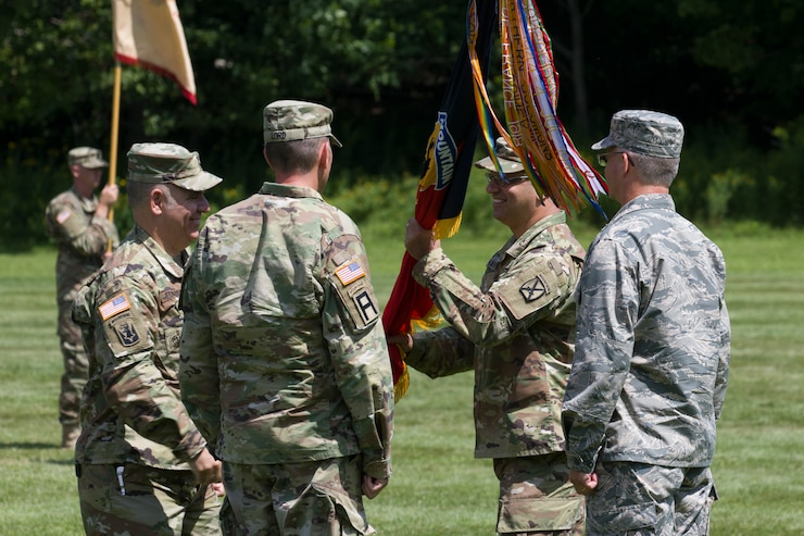 Outgoing commander Col. Andrew Harris relinquished command to incoming commander Col. Nathan Lord during the ceremony.