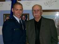 Buffalo, New York, native, U.S. Air Force Maj. Michael Butler, stands with his grandfather, Richard Cunningham, after his commissioning ceremony at Penn State.