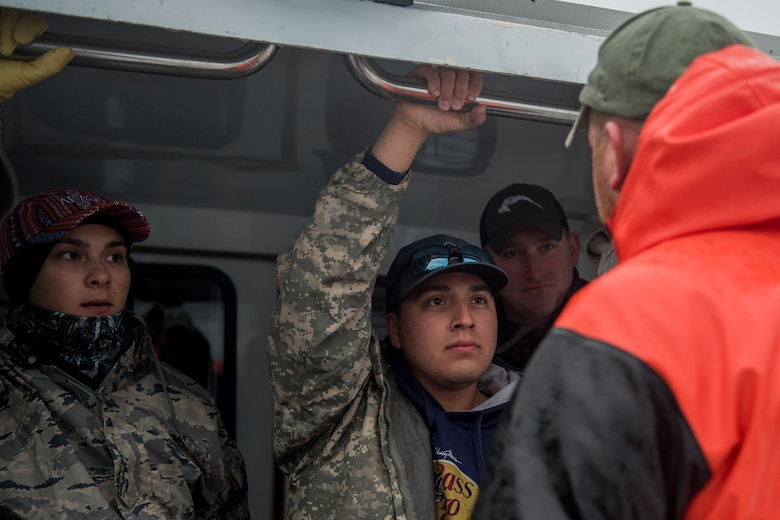 Justin Freimarck, crew member of the Puffin Fishing Charter vessel 'Tenacious,' talks to participants on board during the 2018 Armed Services YMCA of Alaska Combat Fishing Tournament in Seward, Alaska, May 24, 2018. Founded in 2006, the tournament was established as a way of showing thanks and honor to service members through an opportunity to go deep-sea fishing. This is Freimarck's first time participating in the tournament.