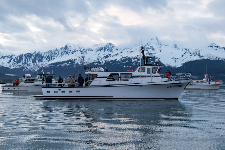 Charter boats line up in the harbor to prepare for the shotgun start during the 2018 Armed Services YMCA of Alaska Combat Fishing Tournament in Seward, Alaska, May 24, 2018. Founded in 2006, the tournament was established as a way of showing thanks and honor to service members through an opportunity to go deep-sea fishing. Because of community support and the volunteerism of the more than 660 crew members and 275 professional fishing charters supplying their time and services, more than 2,400 currently serving military personnel have been able to participate since its inception.