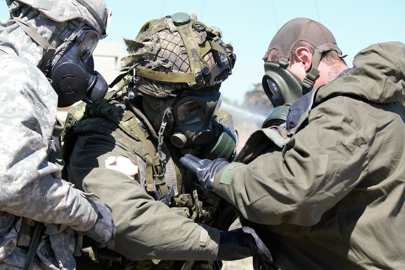 U.S. and Canadian soldiers conduct decontamination operations during Exercise Maple Resolve.