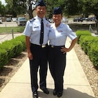 Andrea Aquino and her father Edwin Aquino pose for a photo after her basic military training graduation.