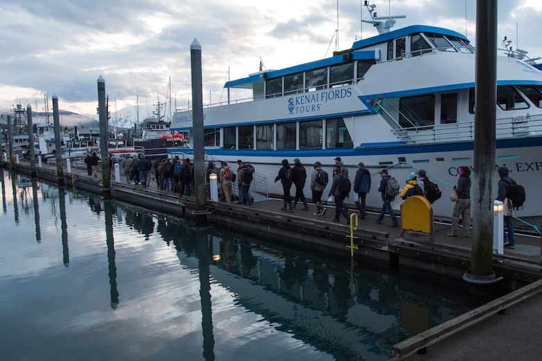 Participants of the 2018 Armed Services YMCA of Alaska Combat Fishing Tournament walk to their assigned charter boats in Seward, Alaska, May 24, 2018. Founded in 2006, the tournament was established as a way of showing thanks and honor to service members through an opportunity to go deep-sea fishing. Because of community support and the volunteerism of the more than 660 crew members and 275 professional fishing charters supplying their time and services, more than 2,400 currently serving military personnel have been able to participate since its inception.