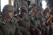 U.S. Marines with II Marine Expeditionary Force Information Group prepare to conduct a static line jump from a CH-53E Super Stallion during exercise Burmese Chase at Camp Lejeune, N.C., May 16, 2018. Burmese Chase is an annual U.S. led multi-lateral exercise that enables U.S. Marines to train with NATO allies and partner nations. This exercise strengthens partner nation security as well as enhances force readiness. (U.S. Marine Corps photo by Lance Cpl. Caleb T. Maher)