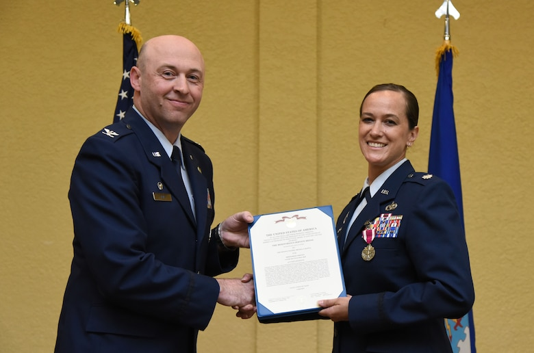 U.S. Air Force Col. Danny Davis, 81st Mission Support Group commander, presents the Meritorious Service Medal certificate to Lt. Col. Melissa Rativa, outgoing 81st Logistics Readiness Squadron commander, during the 81st LRS change of command ceremony in the Bay Breeze Event Center at Keesler Air Force Base, Mississippi, May 23, 2018. The ceremony is a symbol of command being exchanged from one commander to the next by the hand off of a ceremonial guidon. Rativa relinquished command of the 81st LRS. (U.S. Air Force photo by Kemberly Groue)