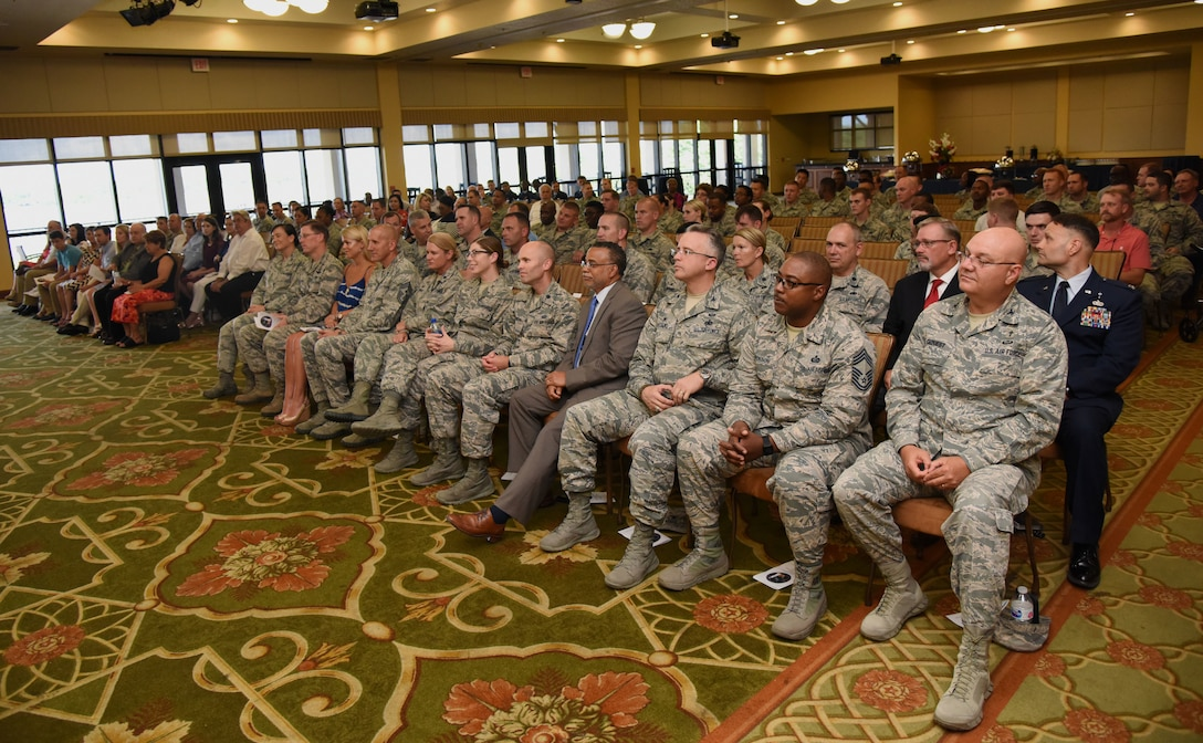 Keesler personnel, families and friends attend the 81st Logistics Readiness Squadron change of command ceremony in the Bay Breeze Event Center at Keesler Air Force Base, Mississippi, May 23, 2018. The ceremony is a symbol of command being exchanged from one commander to the next by the hand off of a ceremonial guidon. U.S. Air Force Col. Danny Davis, 81st Mission Support Group commander, passed on command of the 81st LRS to Maj. Matthew Roberts. (U.S. Air Force photo by Kemberly Groue)