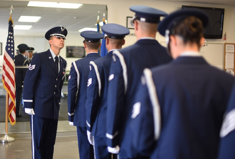 U.S. Air Force Staff Sgt. Steven C. Flynn, Travis Air Force Base Honor Guard lead instructor, completes a uniform inspection on other HG Airmen May 22, 2018, at the Honor Guard building at Travis AFB, Calif. The Travis Honor Guard's area of responsibility spans 45,000 square miles serving 28 counties with 1 million veteran residents.  (U.S. Air Force photo by Airman 1st Class Jonathon D. A. Carnell