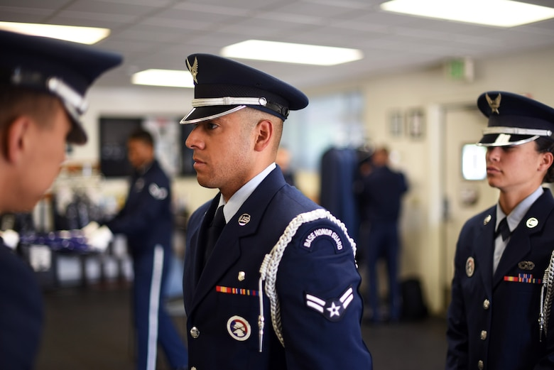 U.S. Air Force Staff Sgt. Steven C. Flynn, Travis Air Force Base Honor Guard lead instructor, inspects the ceremonial uniform of Airman First Class Mario Hernandez, 60th Medical Operations Squadron aerospace medical technician, May 22, 2018, at the Honor Guard building at Travis AFB, Calif. The Travis Honor Guard's area of responsibility spans 45,000 square miles serving 28 counties with 1 million veteran residents.  (U.S. Air Force photo by Airman 1st Class Jonathon D. A. Carnell)