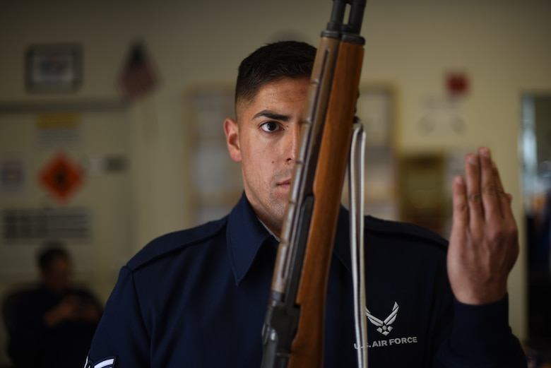 U.S. Air Force Airman First Class Mario Hernandez, 60th Medical Operations Squadron aerospace medical technician, practices firing party movements May 18, 2018 at the Honor Guard Building at Travis Air Force Base, Calif. Travis' Honor Guard covers 45,000 sq. miles to include four National cemeteries, two Veterans Administration cemeteries and every private resting area between. (U.S. Air Force photo by Airman 1st Class Jonathon D. A. Carnell)